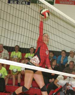 Allie Njus goes up for the kill. (Photo by Jennifer Bissell)