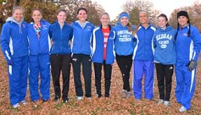 The Decorah girls cross country team secured its ninth straight NEIC title and 13th in school history. Pictured are varsity team members, from left - Head Coach Cristy Nimrod, Linnea Kephart, Alice Gullekson, Shelby Varney, Stefanie Bjerke, Shana Kelly, Brinn Anderson, Gara Lonning and Assistant Coach Sarah Nowack. (Photo courtesy Clara Knudson)