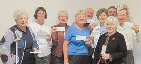 "Members of the Winneshiek County Historical Society Board are pictured with their $50 contributions to the ""$50 for 50"" campaign which will fund a $10,000 Winneshiek County Historical Society Endowment with the Winneshiek County Community Foundation. From left are: Naomi Craft, Midge Kjome, Ferneva Brimacomb, Sharon Rossman, Carleton Haugen, LaVonne Sharp, Kevin Lee, Paul Hexom and Barbara Berg (in front). (Submitted photo)"