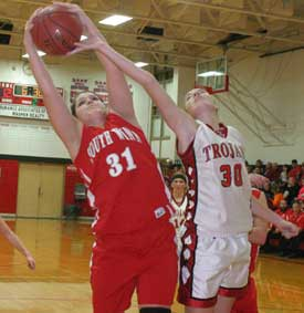 South Winn's Jenn Panos (No. 31) goes for the rebound in a recent game. (Photo by Jennifer Bissell)