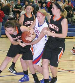 Tess Olinger battles with a Comet player for a rebound Tuesday. (Photos by Jennifer Bissell)