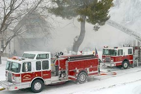 Decorah firefighters were faced with snow-covered streets, chilly temperatures and strong winds Thursday afternoon as they battled a house fire at 610 W. Main St. (Decorah Newspapers photo by Lissa Blake
