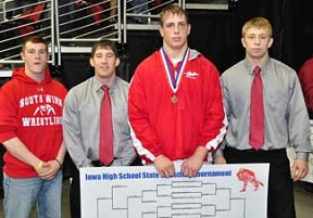 South Winn's Nick Schmelzer (second from right) became just the second South Winn wrestler in school history to win a title at the state wrestling meet. Schmelzer was the 220 pound champion in Class 1A. Pictured are, from left - Ethan Adams, Coach Jacob Elsbernd, Schmelzer and Assistant Coach Jason Schmelzer.