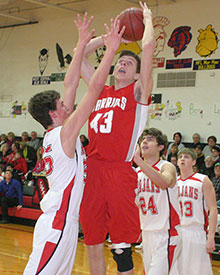 Adam Lensing scored 12 points Monday against Waukon. (Photo by Jennifer Bissell)