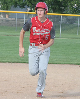 Treyton Jacobsen races to third base in a recent game. (Photo by Jennifer Bissell)