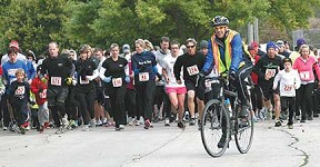 Rotary member Dr. Kelly Reagan of Decorah leads the way as runners take off on the 5K race during the Decorah Rotary Club's Loop de Loop last year.