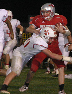 Christian Kleve carried the pigskin for the Warriors. (Photo by Jennifer Bissell)