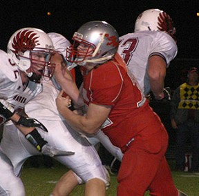 Sophomore Ben Klimesh takes on a South Hamilton lineman late in the game. (Photo by Jennifer Bissell)
