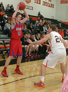 Chris Hartman looks to make the pass inside, with Parker Hesse defending. (Photo by Jennifer Bissell)