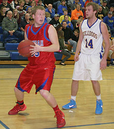 Decorah senior Kyle Kane looks to back in on MFL's Cody Mason from last week's game in Monona. (Photo by Jennifer Bissell)