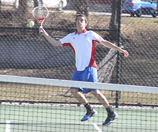 T.J. Misseldine returns the ball during Thursday's home match. (Photo by Jennifer Bissell)