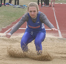 Decorah's Katelyn Dehning leaps 14 feet, 8.25 inches in the long jump competition Thursday, earning fifth.