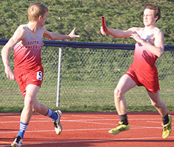 South Winn's Nathan Meyer (R) hands off to Devin Franzen in the JV 4x200 relay. Along with Mitch Herold and Garrett Bohach, the quartet took first. (Photos by Jennifer Bissell)