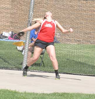 Chloe Reicks scored four points for her team by finishing fifth in the discus Friday. (Photo by Jennifer Bissell)