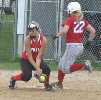 Turkey Valley first baseman Allison Kuennen tries to hold on to the ball while Decorah's Maria Hoyme speeds down the line. (Photo by Jennifer Bissell)