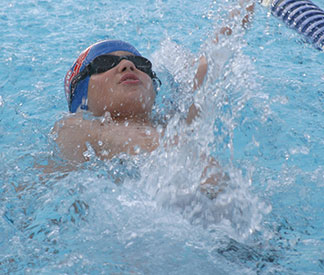 Tyler Irwin competes in the backstroke Tuesday.