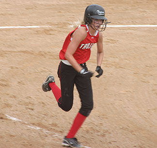 Turkey Valley freshman Shelby Reicks races to first base in a recent contest. Reicks and the rest of the Trojans started the postseason Wednesday night at home against Riceville. The winner moves to face either Kee or Central Friday, July 11. (Photo by Jennifer Bissell)