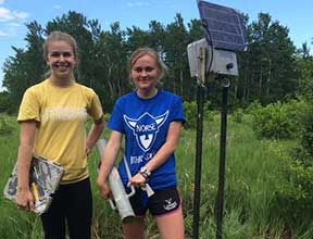 Luther students Mariah Crotty and Andrea Malek are working with Dawn Reding, Luther visiting assistant professor in biology, using several methods to survey bat populations and estimate bat mortality caused by the sweeping rotor blades. (Submitted photo)