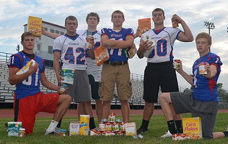 DHS scrimmage, canned food drive Friday