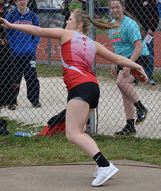 South Winn's Kaylie Rommes starts her wind up before releasing the discus in the varsity competition. (Photo by Becky Walz)