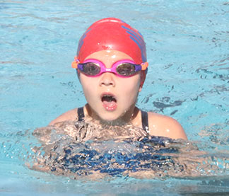 Abby Bahr takes a breath during the breaststroke. (Photo by Jennifer Bissell)