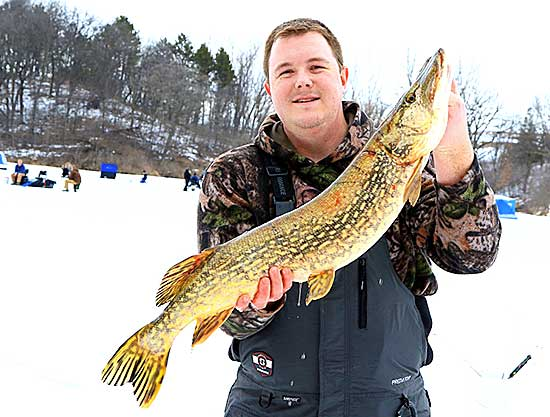 John Budweg with the 8.6 pound Northern he caught during last year's ice fishing derby.