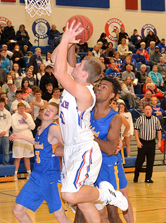 Decorah's Logan Halverson goes to the hoop against stiff Wahlert pressure early in Tuesday's home nonconference game. The junior had eight points in the Vikings' 74-50 effort. (Photo by Becky Walz)