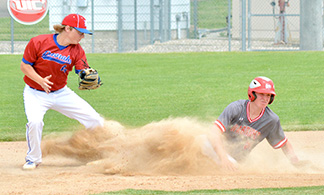 South Winn's Jacob Herold slides into second in a cloud of dust as Viking Jace Johnson looks to slap the tag on for an out. Herold was called safe on the play and later scored the winning run for the Warriors in the sixth inning Saturday afternoon. (Photo by Becky Walz)