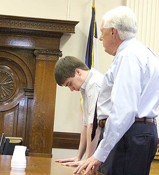 Jacob Seelinger, 18, Decorah, listens as his verdict is read at the Winneshiek County Courthouse Thursday afternoon. Seelinger, who was on trial for first-degree murder in the death of David Hansen, 46, Decorah, last summer, was found guilty of second-degree murder. A presentence investigation will take about six weeks and will take into account the defendant was 17 at the time of the crime. (Decorah Newspapers photo by Sarah Strandberg)