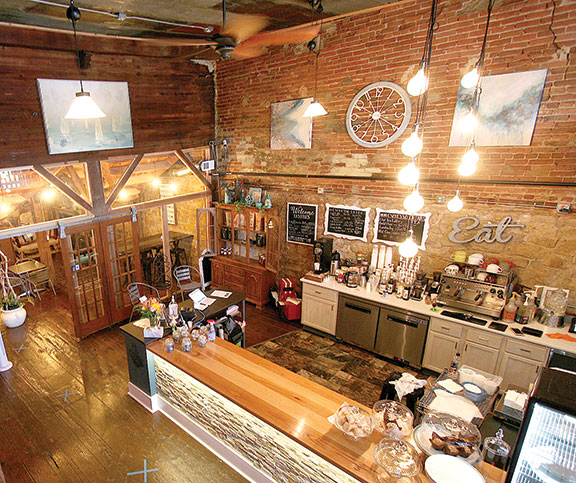 Lansing's newest eatery, Coffee on the River, sits alongside the Mississippi River, with dock access in back of the historic building that houses the coffee shop. (Photo by Julie Berg-Raymond)