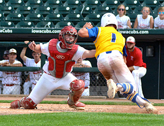 South Winn catcher Kody Kleve lays the tag on the Don Bosco runner during Friday's Class 1A quarterfinal at Principal Park. (Photo by Becky Walz)