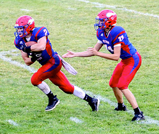 Cael Luzum (2) had 61 rushing yards in 14 carries and one touchdown for the Vikings, while QB Briggs Duwe (11) passed for 195 yards and a trio of scores Friday. (Photo by Tami Bohr)