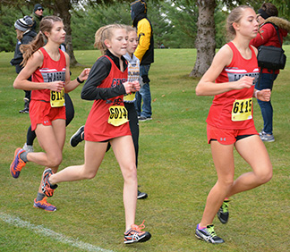 SW junior Eryn Sabelka (left) and freshman Josie Tieskoetter (right) both punched individual tickets to the state cross country meet by finishing in the top 10 at Guttenberg Friday. (Photo by Becky Walz)